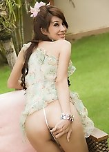 Beautiful Ladyboy Ne plays with her big smooth cock outside in garden