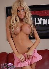 Busty transsexual goddess Kimber James stripping