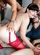 Dolled up in glamorous lingerie and high heels, T-girl Natalie Mars gets gangbanged by five studs.