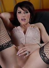 Beautiful transsexual Eva fucks a toy
