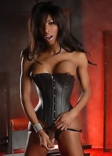 Hot ebony tgirl Natassia posing in sexy black corset
