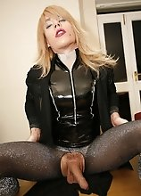 Blonde Zoe cuts open her tights and plays with her cock