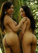 Sexy Carmen posing with Mia on a mystical tree