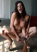 Naughty transsexual Morgan playing with a rifle