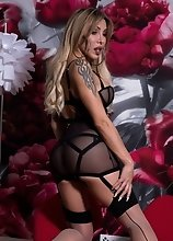 Watch the hot and sexy Eva Paradis get hot, horny and naked behind the flower wall