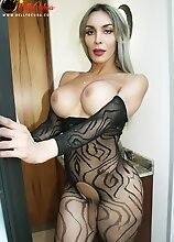 Big Tits and Big Ass on this Sexy Tranny in Lace Bodystocking