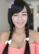 20yo cute Thai ladyboy striptease for tourists camera