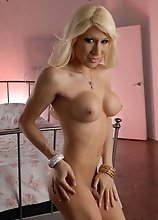 Sexy cowgirl Victoria Di Prada stripping in the bedroom