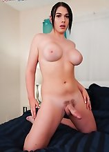 Superstar Aspen Brooks shows off her big boobs then strips down and strokes her big cock in this smashing solo scene!